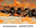 Small photo of Macro photo of grated carrot on mandoline slicer blades, extreme close up of mandoline vegetable slicer.