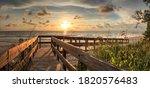Boardwalk leading toward Delnor-Wiggins State Park at sunset in Naples, Florida.