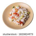 rice with vegetables on beige...