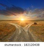 fork roads in steppe on sunset... | Shutterstock . vector #182120438
