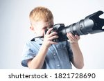 Boy With A Large Camera Lens....