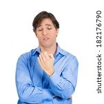 Small photo of Closeup portrait of goofy, aggravated, irate young man looking at his hand, bored out of his mind, isolated on white background. Negative human emotion facial expression feelings, reaction, attitude