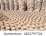 Africa, Madagascar, Antananarivo. Bricks are set out to dry in an interesting pattern.