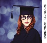 Small photo of graduating student girl in an academic gown.