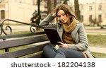 young woman sitting with tablet ...   Shutterstock . vector #182204138