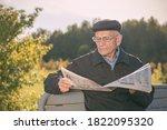 Elderly man wearing cap and...