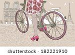 woman riding a bicycle in paris | Shutterstock .eps vector #182221910