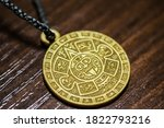 Small photo of Amulet that attracts good luck. Amulet for a person. Talisman stone of the sun, Calendar of the Aztecs