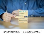 """Small photo of Text """" SEO 2021"""" on wooden block. concept for promoting website traffic, ranking, optimizing your website to rank in search engines or SEO."""