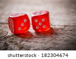 pair of thrown red dices on old ... | Shutterstock . vector #182304674