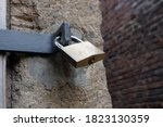 Metal Padlock At An Old Wooden...
