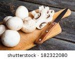 Fresh Mushrooms On Cutting Board