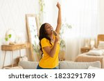 Cheerful black woman with...