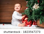 Cute Child With Christmas Tree. ...