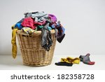 overflowing laundry basket.... | Shutterstock . vector #182358728