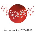 Traditional Japanese white and red origami cranes flying over stylized Japanese flag - stock photo