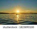 Sunset On Sea With Little...