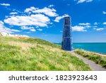 Small Blue Lighthouse Near...