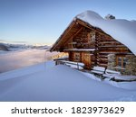 Snow Covered Mountain Hut Old...