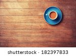 cup of  offee on a wooden table. | Shutterstock . vector #182397833
