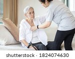 Small photo of Asian daughter in charge is helping to dress up,chang clothes for a helpless old patient,taking care of senior mother suffer from stroke,lacking strength,decrepit of person,elderly woman and infirm