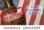 Small photo of Concept for problems in deciding Presidential election in the USA with judge's gavel and american flag and the mention rejected