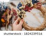 Girl Making Floral Door Wreath...