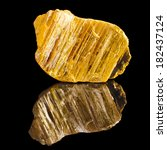 Small photo of Orpiment with reflection on black surface background