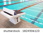 A Blue Swimming Pool With...