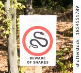 Small photo of The symbol warns of the danger that snakes are here, Venomous snake warning, forest, walk, snakes, danger, death, nature, spring, rest, love, nature, poison, bite, snake venom, wild forest, safety
