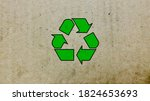 recycling icon on brown carton... | Shutterstock . vector #1824653693