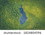 Small photo of Aerial summer view of a Finland shaped lake in Finnish Lapland