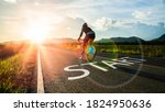 Small photo of Concept of start straight and beginning for cooperation.Blurry Man ride on bike and word start written on the road at sunset add lens flare.Concept of challenge or career path,business strategy.