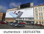 Small photo of Prague, Czech Republic - February 24 2020: Gigantic billboard advertising new smartphone covering whole buildings