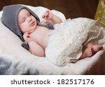 newborn baby girl asleep on a... | Shutterstock . vector #182517176