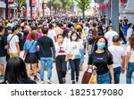 Small photo of Wuhan China , 1 October 2020 : Crowd of people wearing surgical face mask on the 2020 China national day and first day of golden week holidays in Jianghan pedestrian road in Wuhan Hubei China