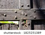 Old Wooden Door With Metal...