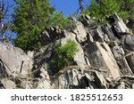 A Rocky Mountain Cliff With...