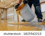 Worker Applying A Yellow Epoxy...