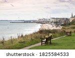 Coastal Town And Wind Turbines