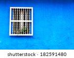A Blue Colonial Wall With A...