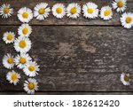 flowers on wooden background | Shutterstock . vector #182612420