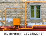 Orange Pipes Of Gas Hub With...