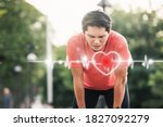 Small photo of Man runner athlete chest injury and pain. sport man having chest pain after running in the park , heart attack. Asian cardiac arrest running young man heart attack in park.