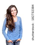Small photo of Young woman posing and smiling over white background