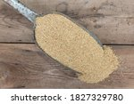 A Shovel Spoon With Birdseed On ...