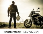 Biker Standing With Its...