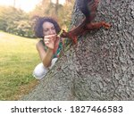 Woman Feeding A Squirrel At Th...