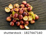 Chestnuts On A Pile With A...