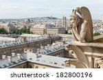 A Bored Gargoyle Sits On Top Of ...